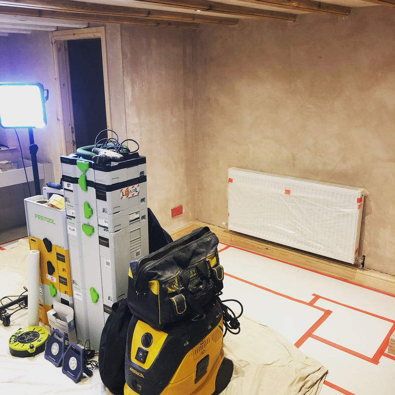 Paper floor protection and plastic surface protection being used on a painters work site.
