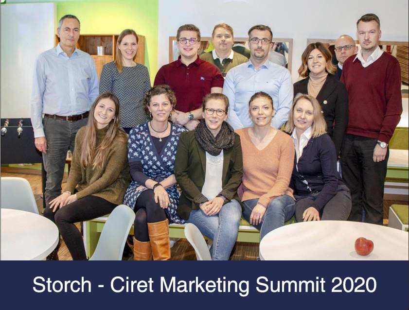 Group photo of Storch-Ciret team members at a summit.