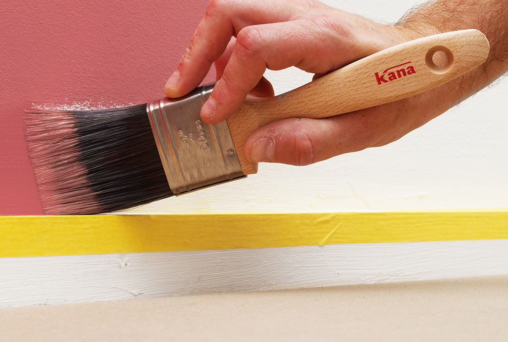 Paint brush from the Kana brand is used to paint above skirting board.